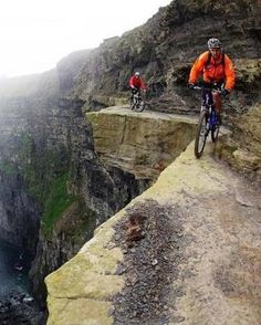 Mountain Biking Cliffs of Moher - Ireland <3 Freak me out!!!!!!!!! More like give me a heart attack Adrenalin rush