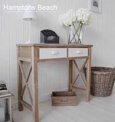 Image from http://www.thewhitelighthousefurniture.co.uk/be-inspired/images/hall-hamptons-beach.jpg.