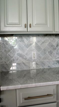Backsplash - sometimes its all about the layout. Takes subway tile and transforms it into something classic, yet unexpected.
