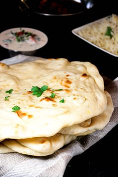Naan is an Indian bread made with yeast. It can be made in the oven or in a pan. Perfect for scooping up your favorite curry!