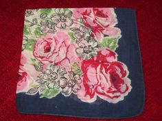 Pink roses and navy blue trim on this lovely vintage hankie....I have one just like this!