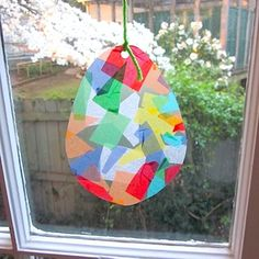 Easter egg sun catcher with tissue paper squares. Would be fun to make butterflies with this technique