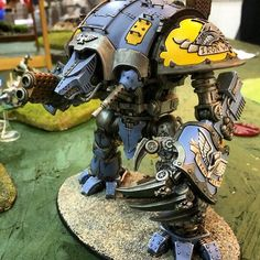 Unique Custom Imperial Knight. Probably has some honor ties to the Space Wolves to have modified their knight so.