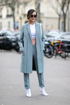 PARIS, FRANCE - MARCH 02:  Chriselle Lim wears a white top, a long jacket, white shoes, black and white pants, outside the Paco Rabanne show, during Paris Fashion Week Womenswear Fall/Winter 2017/2018, on March 2, 2017 in Paris, France.  (Photo by Edward Berthelot/Getty Images) via @AOL_Lifestyle Read more: https://www.aol.com/article/lifestyle/2017/03/09/best-street-style-paris-fashion-week-fall-2017/21878780/?a_dgi=aolshare_pinterest#fullscreen