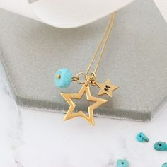 Personalise this gorgeous shiny sterling silver, rose gold or gold  star pendant necklace with her initial and turquoise birthstone charms  to create a unique keepsake gift for her.#jewellery #necklace #star #silver #gold #rosegold  #birthstone #turquoise #december #birthday #personalised #gift #women