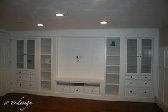 Wall of built-ins made out of Ikea cabinets. Perfect for a finished basement.