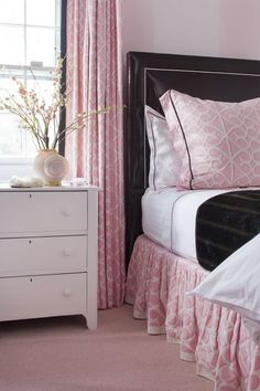 Pink is a soothing color for bedrooms. Accessorizing it with a black bed and a black accent blanket helps it to feel more modern and less like a Barbie bedroom.