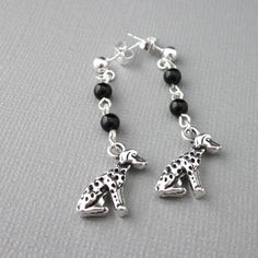 Irresistible dalmatian dog earrings have smooth and glossy black onyx gemstones and sterling silver post ear wires with sterling silver backing clutches. The silver tone metal alloy dog charms are...@ artfire