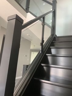 Gorgeous hardwood stairs couldn't be showcased any better than with custom made glass panels #glassstaircase #homedesign  #modernhomedecorideas