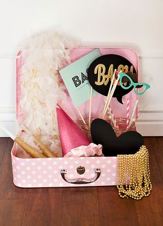 Love how Bash by Brenly used a vintage suitcase to store the photo booth props!