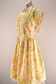 I seem to like yellow ones but i don't like yellow. Love the pleated parts 1960s floral day dress / Vintage summer dress / 60s