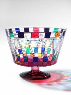 Mindy hand paints all of her glassware then fires it to make the paint permanent.