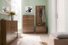 OPEN BRW Entrance Hall furniture set. The colour of 'virginia nut' with a visible pattern of wood introduces a cosy mood into the room. The products from the Open line are also very functional. High cabinets and capacious wardrobes will hold a considerable quantity of clothes, deep drawers will hide all accessories and all-purpose shelves will allow for the maximum use of the space. Polish BRW Modern Furniture Store in London, United Kingdom #furniture #polish #brw #hallway #entrancehalls