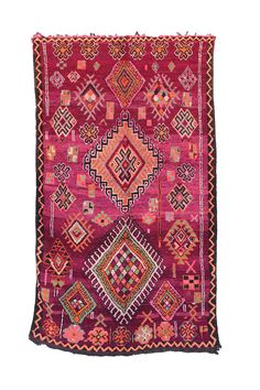 """5'5"""" x 9'2"""" $1850 // FREE shipping worldwide. Boujad rugs are hand woven pile rugs from a small region in Haouz between the Middle Atlas and the Atlantic ocean.  Made by the women, these rugs play with bold strong colours - pinks, purples, oranges & reds - each piece telling a tale with the use of traditional Berber lozenges & motifs - making references to fertility, rural life, marriage, spiritual beliefs and more.  Size: 5'5"""" x 9'2"""" feet / 165 x 280 cm Age: Circa 1970s Condition: Excel..."""