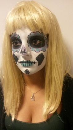 Sugar skull by snazeroo paints b purple and green simple design