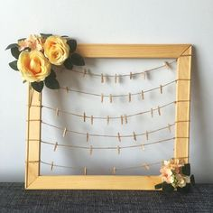 Handmade wooden frame, with pegs for you to clip wedding photos/polaroids during wedding reception. Artificial flowers at the side as decoration. Frame size 50cm(L) x 45cm(H)Only used once. Guaranteed good condition.