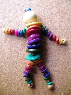 Hinterland Mama: Thought I'd make a Button Doll, from repurposed craft items