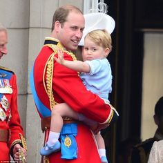 Prince George joins his family on the balcony of Buckingham Palace for his first Trooping the Colour! He's wearing n outfit his father, Prince William, wore for the 1984 Trooping the Colour!