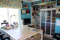 Pretty and organized craft room!  I love the turquoise walls!