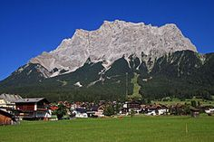 The Zugspitze, at 2,962 metres above sea level, is the highest peak of the Wetterstein Mountains as well as the highest mountain in Germany. It lies south of the town of Garmisch-Partenkirchen, and the border between Germany and Austria runs over its western summit.