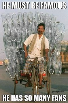 Funny Picture Of Man With So Many Fans