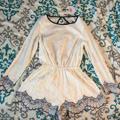 Romantic romper Romantic lace detailed romper. Delicate trim details on sleeves and bottoms. Open back with blue trim detail. Other