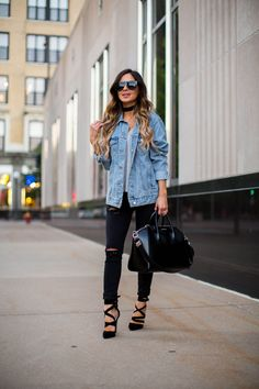 fashion blogger mia mia mine wearing a topshop denim jacket and black ripped jeans