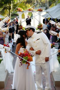 Who doesn't love a man in uniform? The military wedding is one of the most symbolic moments for a soldier. Baring his best uniform, a Military wedding is an event beyond your typical wedding. As you can see the fashions are all markers that reiterate the grooms status as a military man. From head to toe, from isle to alter...everything screams military!