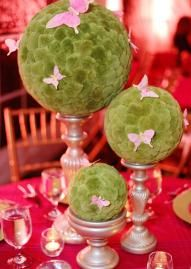 Butterflies are great accents for these green pom balls. Photo by Chelsea Beck Photography. #wedding #butterfly #centerpiece