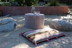 Pink tasseled cushion in Topanga Canyon garden.