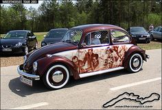 Brown VW Beetle with airbrushed mural at the Wörthersee Tour GTI-Treffen 2013
