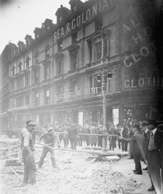 Bomb damage to buildings and the road surface on Minories, London, following the Zeppelin raid on the night of 13 - 14 October 1915 that claimed the lives of 71 people.