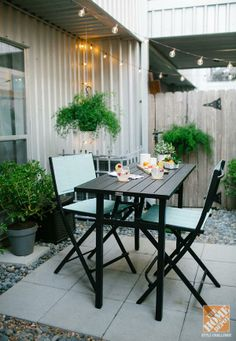 The Martha Stewart Living Franklin Park High Patio Dining Table is the centerpiece of this gorgeous small urban patio styled by blogger Ashley Rose of Sugar & Cloth.    @Ashley Rose / Sugar & Cloth