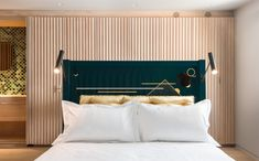 The lacquerware headboard on the master bed is by Pedro da Costa Felgueiras of the New Craftsmen. #remodelista #remodel #bedroom #masterbedroom #headboard