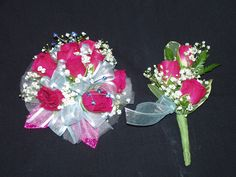 Wrist Corsage with hot pink spray roses, baby breath, with hot pink leaves and sheer bow and matching Bout