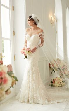 This lace over matte-side satin lustre satin Stella York #wedding gown will ensure you are the center of attention. Features romantic illusion lace sleeves.