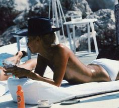 Slim Aarons...for my viewers in Europe. I am glade you know how to fully relax and enjoy life. The House of Q