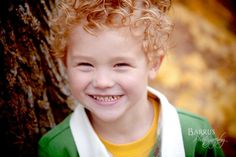 Cute little boy with his curly red hair