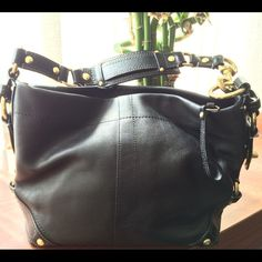 """Black leather, authentic Coach bag! Authentic Beautiful black leather bag with gold hardware... Coach Style 10615 Carly Leather Handbag brass / black  Never used.   *Coach Dust Cover Included *inside zip pocket  *cellphone/multi-function pocket  *ring to clip an accessory or keyfob  *zip-top closure  *black leather with glazed leather trim  *turnlock detail  *fabric lining - olive green *strap with dog leash clip 6 1/2"""" drop  *Dimensions: length 12"""" x height 8"""" x depth 4"""" Coach Bags"""