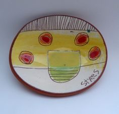 Oval dish with 4 red/pink/orange discs, yellow over lime abstracted half oval shape with linear scratch throughs. 5.5cmsH x 19.5cmsW x 15.5cmsD © Linda Styles Ceramics 2015
