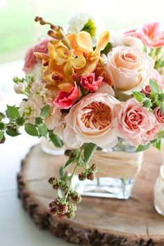 pink, peach and rose wedding florals on a piece of wood  http://www.weddingchicks.com/2013/10/30/peach-and-cream-garden-wedding/