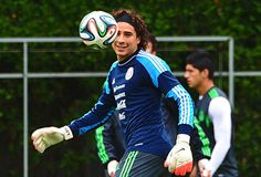 Mexico's goalkeeper Guillermo Ochoa eyes the ball during a training session at the Rei Pele Training Center in Santos, Sao Paulo, on June 19, 2014 as part of the FIFA 2014 World Cup in Brazil.