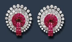 A RARE PAIR OF RUBY AND DIAMOND EAR CLIPS, BY VAN CLEEF & ARPELS   Each designed as a pavé-set diamond stylized wreath, enhanced by an invisibly-set ruby ribbon motif and circular-cut diamond trim, mounted in platinum, circa 1940, in a Van Cleef & Arpels gray suede case  Signed VCA for Van Cleef & Arpels, no. 1577