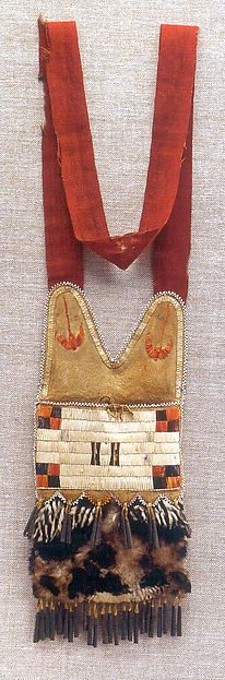 Shot Pouch Date: early 19th century Geography: United States Culture: Mesquakie Medium: Deer (?) skin, bird pelt, porcupine quill, glass beads, metal, cotton Dimensions: H. 11 3/4 x W. 5 1/4 (without strap) Gift of Mr. and Mrs. Charles Diker, 2006 Accession Number: 2006.567.3