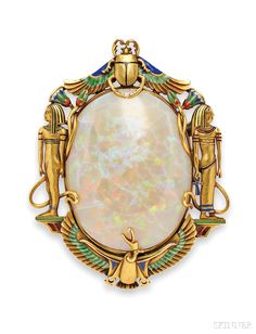 Egyptian Revival 14kt Gold, Opal, and Enamel Brooch, Marcus & Co., the large opal measuring approx. 43.00 x 33.00 mm, framed by ancient Egyptian motifs with enamel accents, lg. 2 3/4 in., signed.