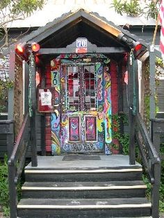 The Red Bar's door, Grayton Beach, Florida. I know the artist,Billie Gaffrey. We painted next to each other at a charity art show in Seaside. She's amazing..and so much Fun!! As if u can't tell from her work!
