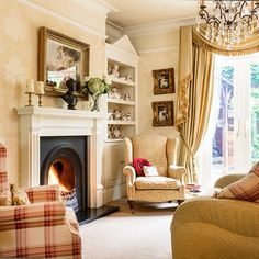 Love this sophisticated living room, complete with curtain swags and tails