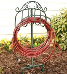 Graceful scrolls of wrought iron give our lightweight, movable Hose Holder an elegant appearance that looks great anywhere in your yard. Three-prong ground stake lets you coil your hose near a flower bed or vegetable garden. Holds of hose. Lawn And Garden, Garden Tools, Garden Bed, Garden Supplies, Garden Projects, Garden Hose Holder, Hose Storage, Garden Organization, Organizing