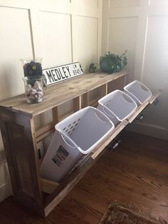 Let me make your laundry look good! Hide it away in any room of your house. You can also use this piece of furniture for hidden recycling. | Etsy $500 2016-04-26 | plans also come from Shanty 2 Chic, using Ana White's tilt-trash can plans