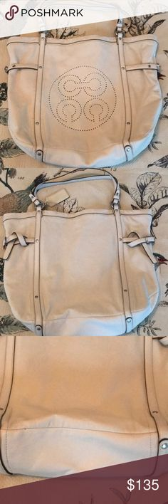 Authentic cream leather Audrey Coach tote Absolutely stunning cream Audrey tote was only used one time. No marks inside or out . Beautiful lavender satiny fabric inside with large zip pocket and two cell pockets,, also key attachment. This beautiful bag has nickel. Hardware Coach Bags Totes